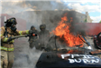 Firefighters fighting car fire