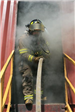 Firefighter coming out of smokey doorway