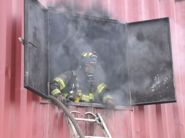 Firefighter in smokey window