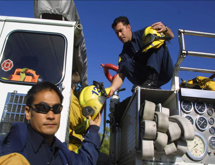 Firefighters on truck