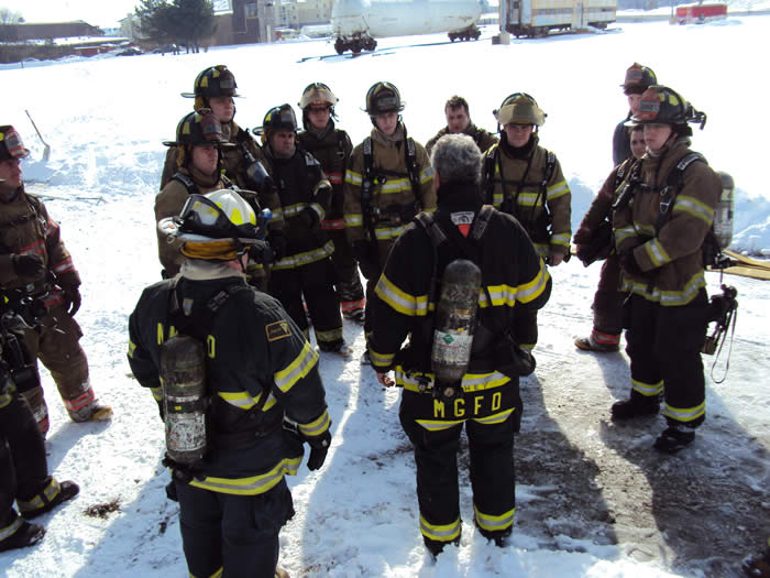 Group of firefighters talking in turn out gear